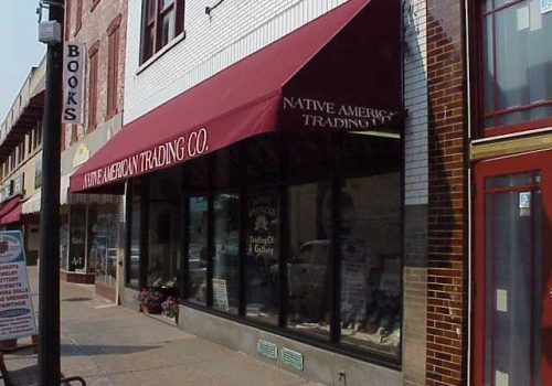 Storefront with awning of the Native American Trading Company on Main Street in HAnnibal